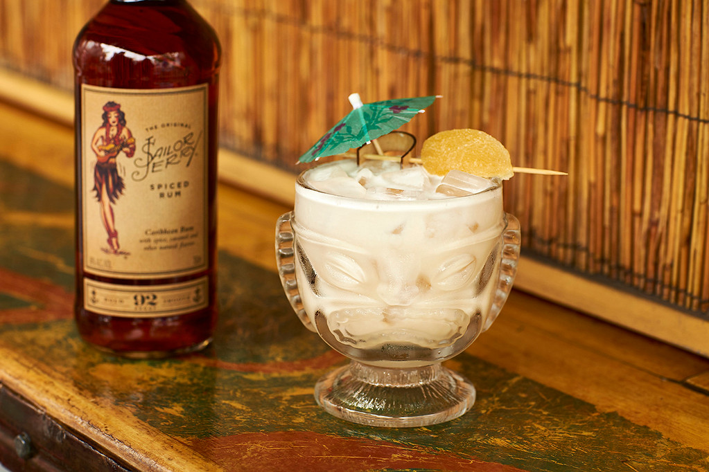 . For National Pina Colada Day (July 10), try a Wahine Pina Colada, featuring Sailor Jerry Spiced Rum, a straight-up, no nonsense, old-school rum. www.sailorjerry.com <br> - 1 ½ parts fresh pineapple juice<br> - 1 ½ parts house-made cream of coconut<br> - 1 ½ parts Sailor Jerry Spiced Rum<br> Combine all ingredients in a shaker and add ice. Shake well and pour into a frozen pineapple. Garnish with sprinkled coconut flakes and an orchid.