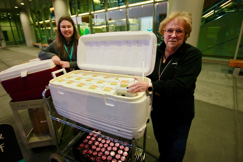 Evergreen Hospital Staff accepting The Herbfarm food package delivery that you all funded