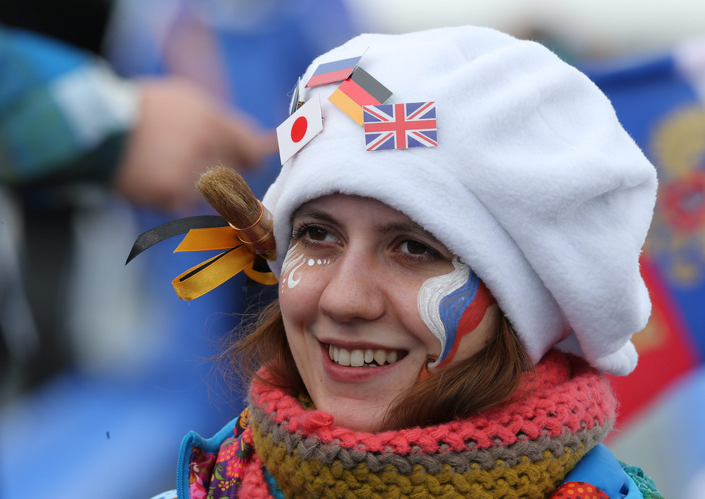 . A spectator watches the Men\'s 15 km + 15 km Skiathlon in Laura Cross-country Ski & Biathlon Center at the Sochi 2014 Olympic Games, Krasnaya Polyana, Russia, 09 February 2014.  EPA/ARMANDO BABANI