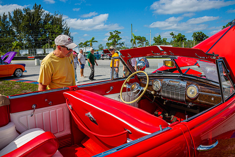 A car enthusiast admires the 1941 Cadillac Convertible Sedan owned by Melvyn Lipsschitz of Palm Beach Gardens at the Super Chevy Show at Palm Beach International Raceway in Jupiter on Saturday, May 25, 2019.  [JOSEPH FORZANO/palmbeachpost.com]