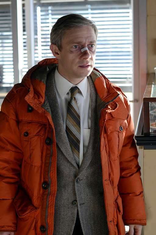 """. This image released by FX shows Martin Freeman as Lester Nygaard in a scene from \""""Fargo.\"""" Freeman was nominated for an Emmy Award for best actor in a miniseries or movie on Thursday, July 10, 2014. The 66th Primetime Emmy Awards will be presented Aug. 25 at the Nokia Theatre in Los Angeles. (AP Photo/FX, Chris Large)"""