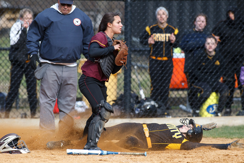 Sheehan's Mikaeyla Daddio (7) checks the bases after tagging out Amity's Jenna Thomas (25) at home Thursday at Amity Regional High School in Woodbridge Apr. 23, 2015 | Justin Weekes / For the Record-Journal