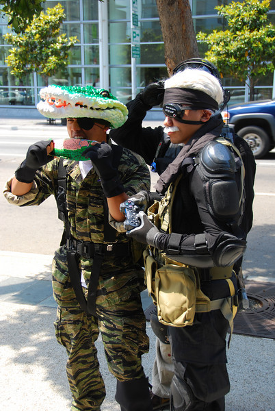 Old Snake and Naked Snake (in Croc camouflage) wait to get their orders from Mr. Kojima.