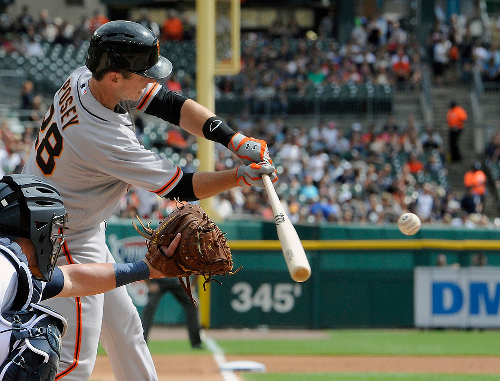 . San Francisco Giants� Buster Posey hits a single against the Detroit Tigers in the first inning of a baseball game Saturday, Sept. 6, 2014, in Detroit, Mich.  AP Photo/Jose Juarez)
