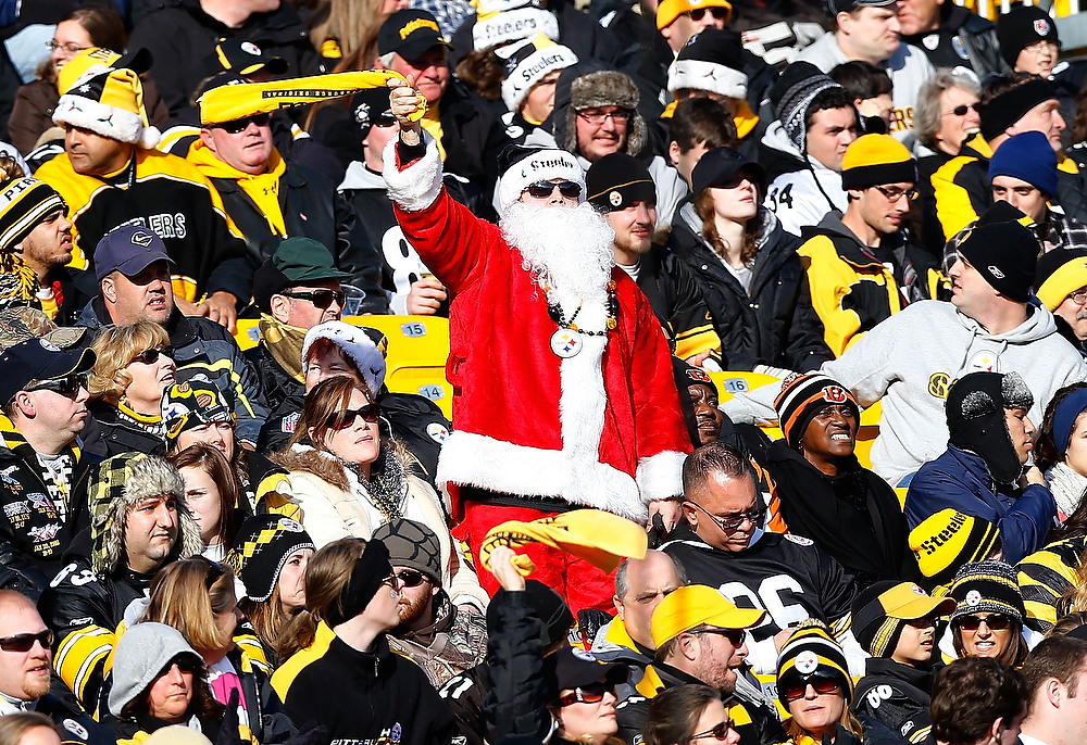 . A fan dressed up as Santa Claus waves his Terrible Towel during the game between the Pittsburgh Steelers and the Cincinnati Bengals at Heinz Field on December 23, 2012 in Pittsburgh, Pennsylvania. (Photo by Jared Wickerham/Getty Images)