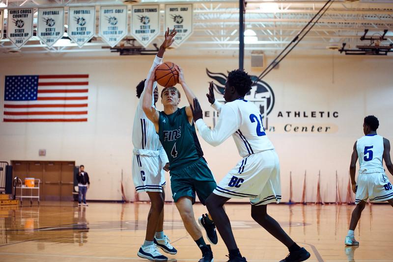 Holy Family Boys Varsity Basketball vs. Brooklyn Center, 12/5/19: David Torborg '20 (4)