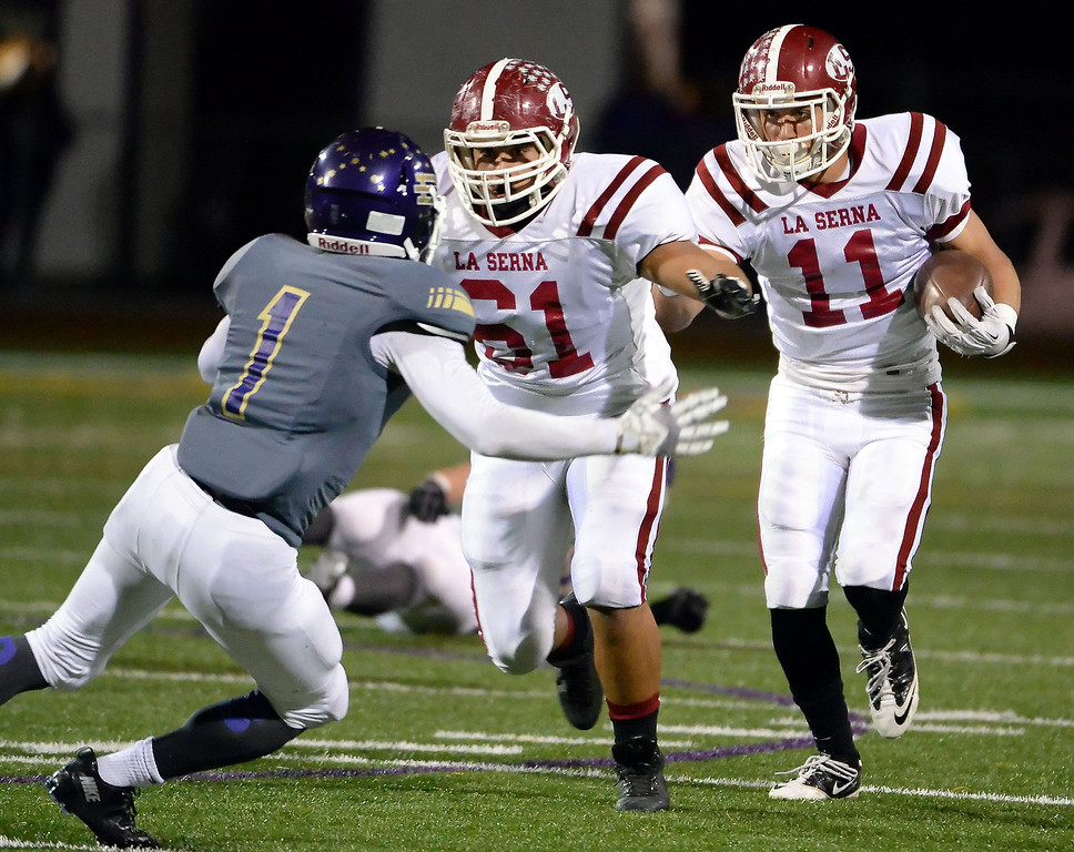 . La Serna\'s Kevin Ramos (11) runs for yardage as Ivan Morales (61) prepares to block Diamond Bar\'s Tyler Brown (C) (1) in the first half of a CIF-SS playoff football game at Diamond Bar High School in Diamond Bar, Calif., on Friday, Nov. 22, 2013.   (Keith Birmingham Pasadena Star-News)