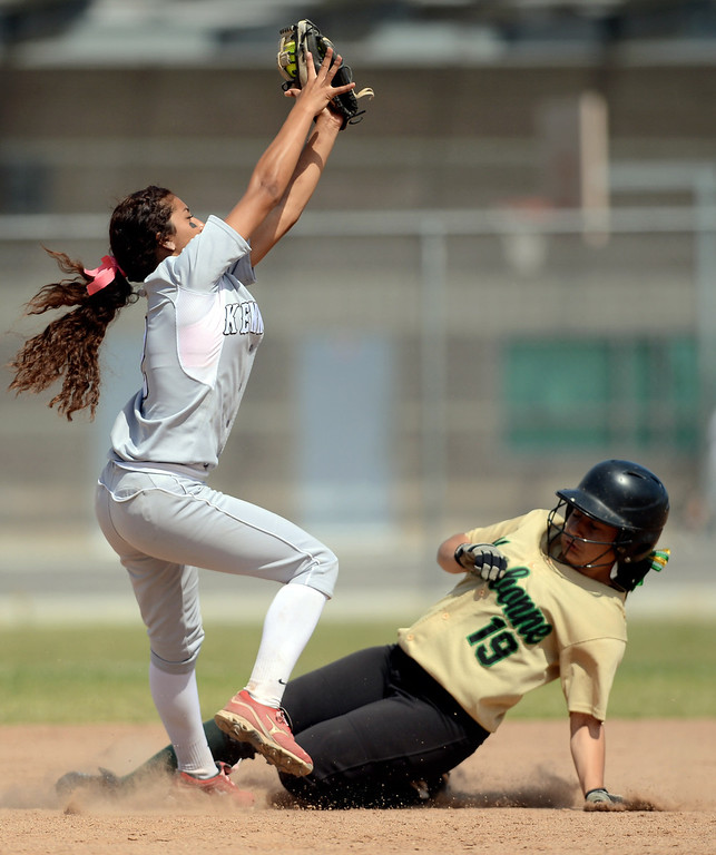 . Narbonne baserunner Lovey Corniel is safe at second as Kennedy\'s Kassandra Bernal makes a catch during the CIF City Section Div. I softball semifinal in Granada Hills, Ca May 21, 2013.(Andy Holzman/Staff Photographer)