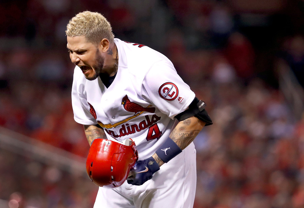 . St. Louis Cardinals\' Yadier Molina yells after popping out to Cleveland Indians catcher Yan Gomes in foul territory to end the third inning of a baseball game Monday, June 25, 2018, in St. Louis. (AP Photo/Jeff Roberson)