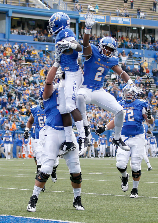 . San Jose State wide receiver Jabari Carr, center, celebrates with teammates David Peterson, left, and Tim Crawley (2) after scoring a touchdown against Colorado State during the first half of an NCAA college football game Saturday, Nov. 1, 2014, in San Jose, Calif. (AP Photo/Tony Avelar)