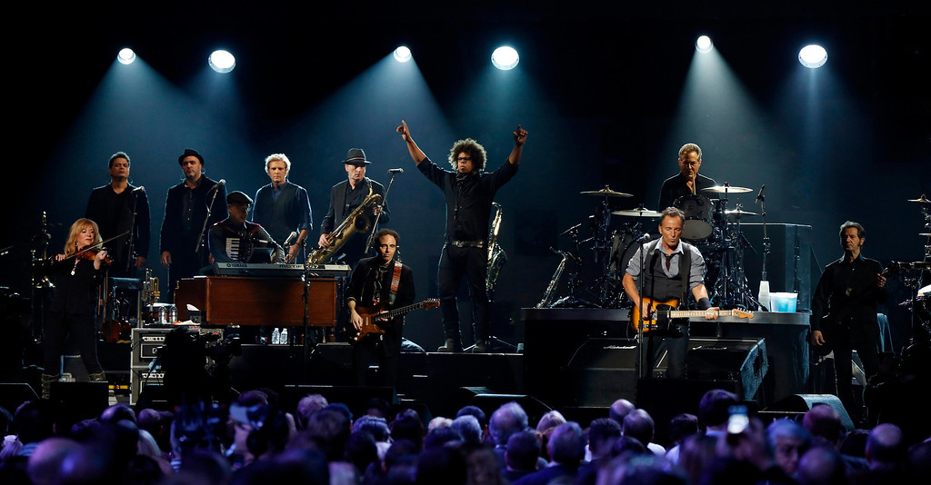""". Saxophonist Jake Clemons (C), nephew of the late Clarence Clemons, performs with singer Bruce Springsteen (R) during the \""""12-12-12\"""" benefit concert for victims of Superstorm Sandy at Madison Square Garden in New York December 12, 2012. REUTERS/Lucas Jackson"""