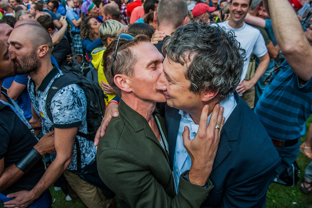 ". Antwerp alderman Ludo Vancampenhout (R) participates in a  \'Kiss-In\' action at the Russian consulate in Antwerp to protest against the treatment of lesbian, gay, bisexual and transgender oriented people in Russia on August 9, 2013.  Russia on Friday said it was unperturbed by threats of an Olympic boycott over a controversial law banning ""homosexual propaganda\"", despite wide-ranging criticism of the legislation from athletes to US President Barack Obama. JONAS ROOSENS/AFP/Getty Images"