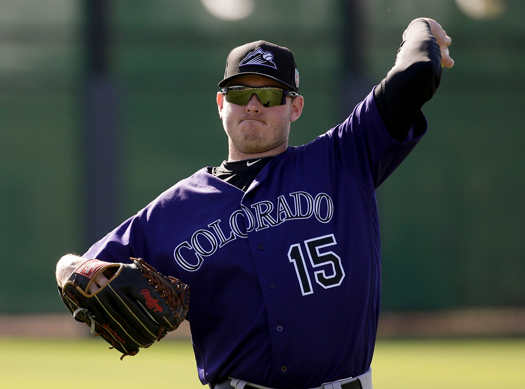 . In this Feb. 22, 2016 photo, Colorado Rockies starting pitcher Tyler Matzek throws during spring training baseball practice,  in Scottsdale, Ariz. Matzek finished strong in 2014, ramping up expectations that the former first-round pick would be a key part of the rotation for the Colorado Rockies.  (AP Photo/Chris Carlson, File)