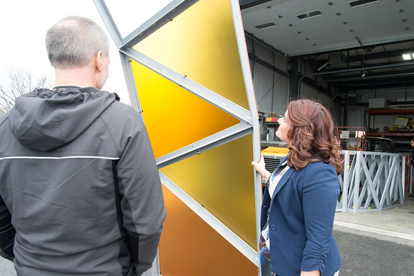 02/15/19 Wesley Bunnell | Staff Mayor Erin Stewart along with Director of Public Works Mark Moriarty look over a colored plexiglass trim piece which is to be installed on the Beehive Bridge project. She visited the manufacturer, Sign Pro, along with other city employees on Friday for a project update.