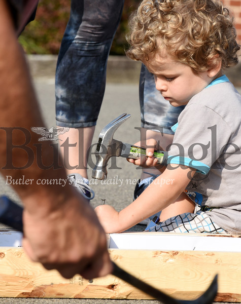 Harold Aughton/Butler Eagle: Elijah Ingram, 4, of Butler, helped to build homes for vets at St. Luke Lutheran Church in Cabot on Sat. Sept. 21.