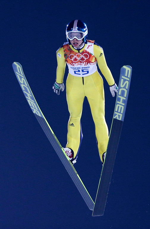 . Slovenia\'s Maja Vtici makes her trial jump in the women\'s ski jumping normal hill final at the 2014 Winter Olympics, Tuesday, Feb. 11, 2014, in Krasnaya Polyana, Russia. (AP Photo/Matthias Schrader)