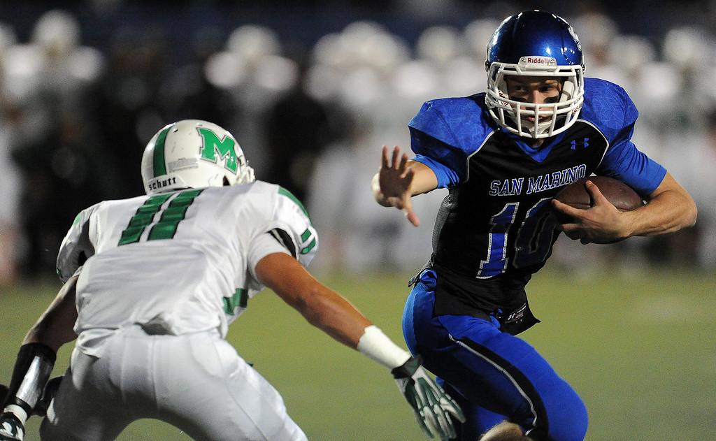 . San Marino quarterback Andrew Ferraco (10) runs past Monrovia\'s Logan Craig (11) for a touchdown in the first half of a prep football game at Monrovia High School in Monrovia, Calif., on Friday, Nov. 8, 2013.    (Keith Birmingham Pasadena Star-News)