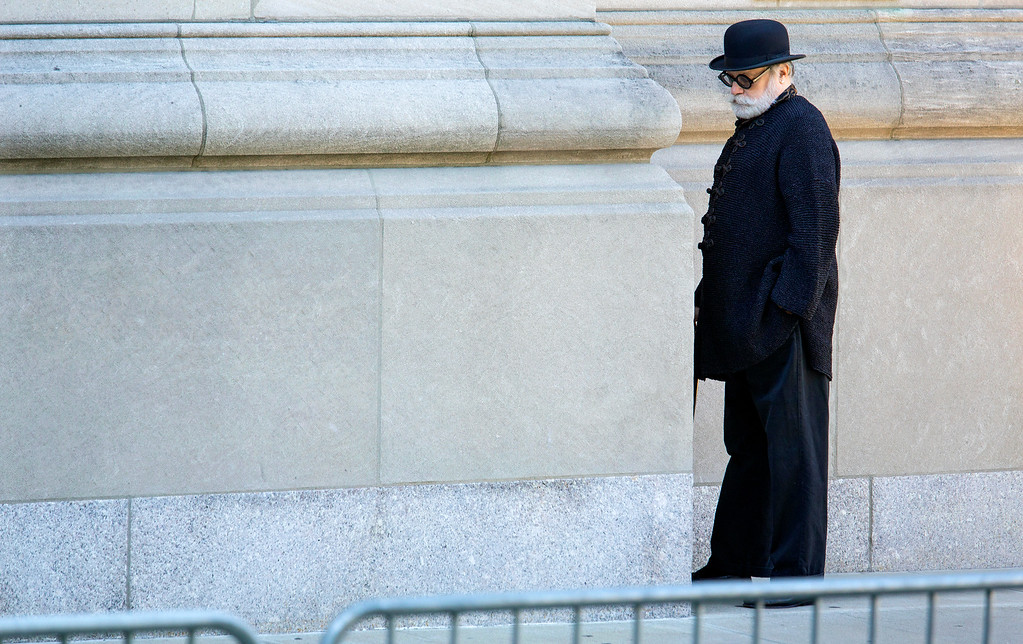 . An attendee pauses as he arrives at a funeral service for comedian Joan Rivers at Temple Emanu-El in New York Sunday, Sept. 7, 2014. Rivers died Thursday at 81. (AP Photo/Craig Ruttle)