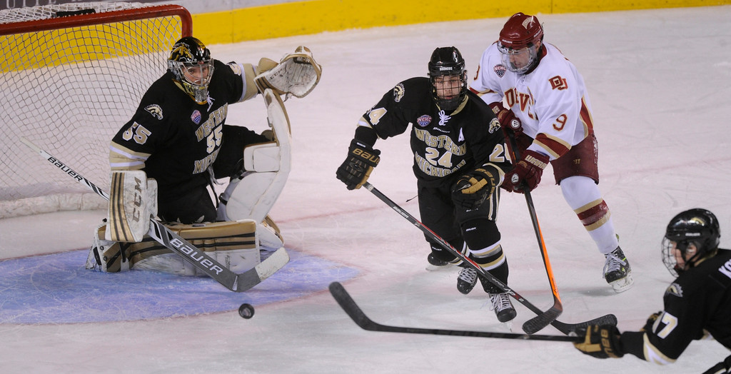 . DENVER, CO. - NOVEMBER 16: Denver center Gabe Levin (9) tried to get past Western Michigan\'s Shane Berschbach (24) in the first period. The University of Denver hockey team hosted Western Michigan at Magness Arena Saturday night, November 16, 2013.  Photo By Karl Gehring/The Denver Post