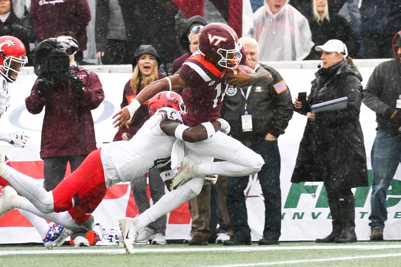 Cincinnati #4 Malik Clements tackles Virginia Tech wide receiver #11 Tre Turner