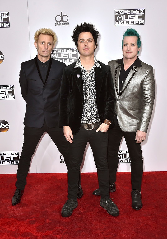 . Mike Dirnt, from left, Billie Joe Armstrong, and Tre Cool, of Green Day, arrive at the American Music Awards at the Microsoft Theater on Sunday, Nov. 20, 2016, in Los Angeles. (Photo by Jordan Strauss/Invision/AP)