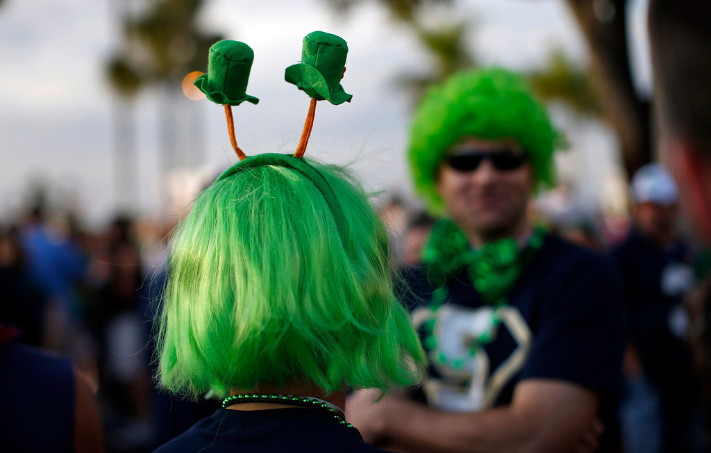 . Notre Dame Fighting Irish fans dressed in costumes stand outside the Sun Life stadium before the BCS National Championship college football game between the Alabama Crimson Tide and the Notre Dame Fighting Irish in Miami, Florida January 7, 2013. REUTERS/Mike Segar