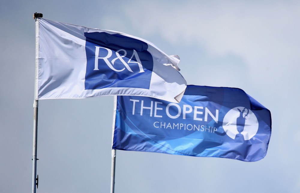 . R&A and The Open Championship flags wave during the first round of the 142nd Open Championship at Muirfield on July 18, 2013 in Gullane, Scotland.  (Photo by Matthew Lewis/Getty Images)