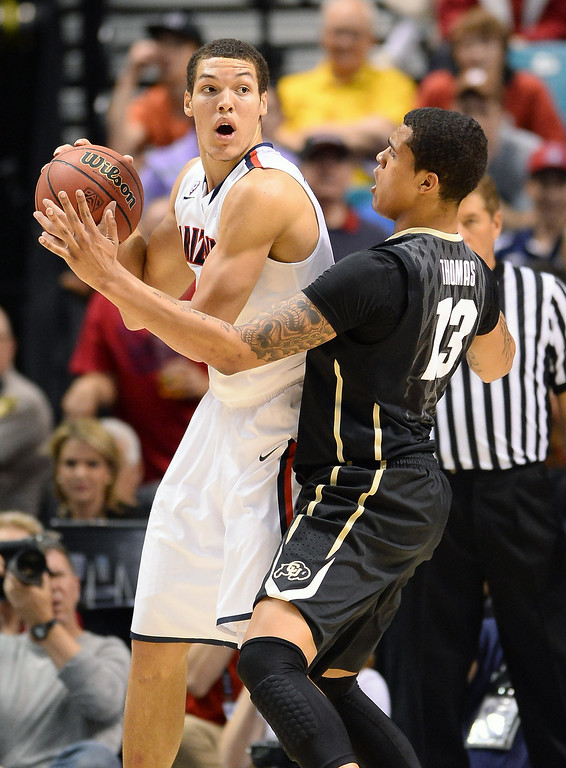. LAS VEGAS, NV - MARCH 14:  Aaron Gordon #11 of the Arizona Wildcats is guarded by Dustin Thomas #13 of the Colorado Buffaloes during a semifinal game of the Pac-12 Basketball Tournament at the MGM Grand Garden Arena on March 14, 2014 in Las Vegas, Nevada. Arizona won 63-43.  (Photo by Ethan Miller/Getty Images)