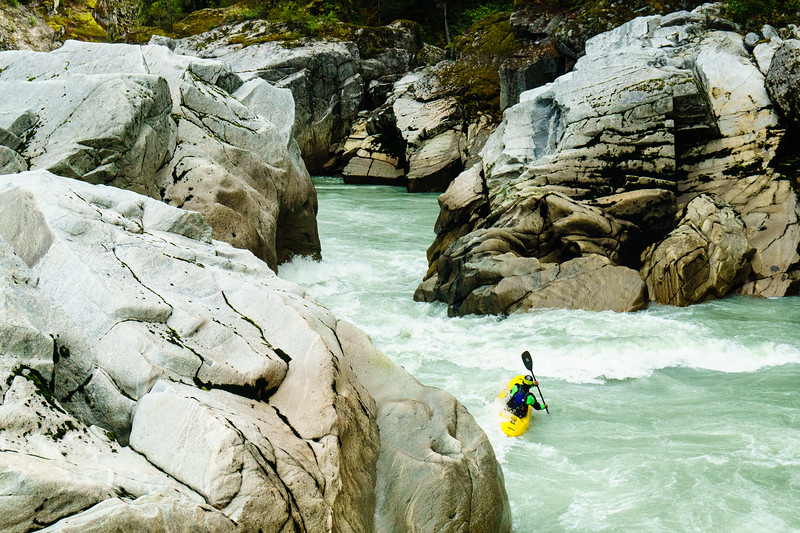 "Harold Schaefer enters ""The Pinch"" on Fear Canyon of the Elaho River outside Squamish, British Columbia."