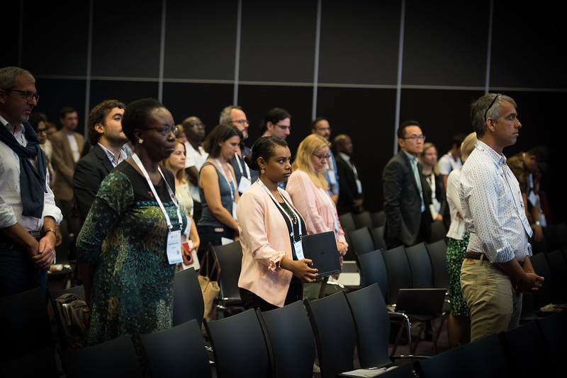 22nd International AIDS Conference (AIDS 2018) Amsterdam, Netherlands   Copyright: Marcus Rose/IAS  Photo shows: TB 2018: Bridging the TB and HIV Communities. Delegates stand in memory of people with TB.