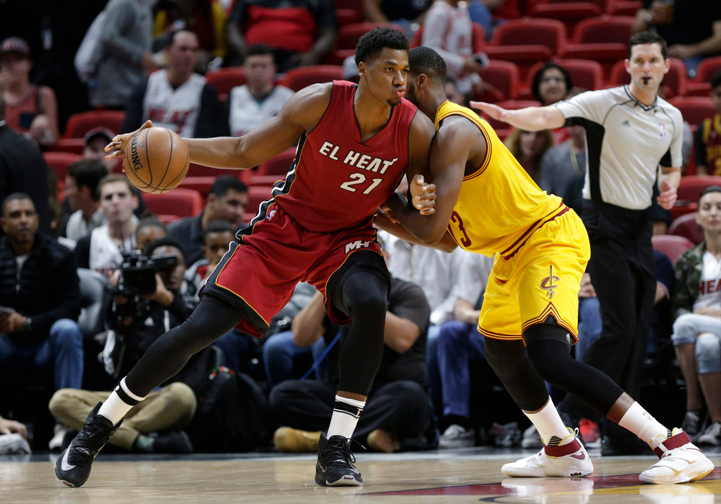 . Miami Heat\'s Hassan Whiteside (21) drives to the basket as Cleveland Cavaliers\' Tristan Thompson defends during the first half of an NBA basketball game, Saturday, March 4, 2017, in Miami. (AP Photo/Lynne Sladky)