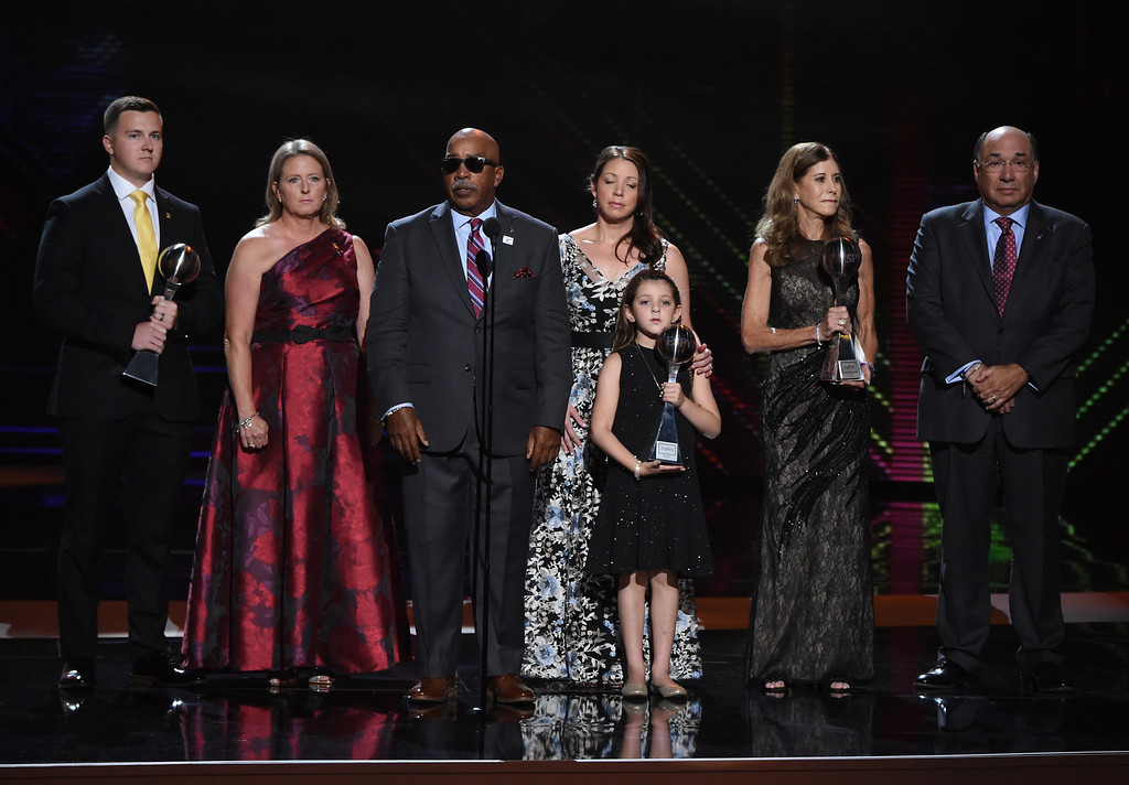 . The families of Scott Beigel, Aaron Feis and Chris Hixon, coaches at Marjory Stoneman Douglas High School, accept the award for best coach at the ESPY Awards at Microsoft Theater on Wednesday, July 18, 2018, in Los Angeles. (Photo by Phil McCarten/Invision/AP)