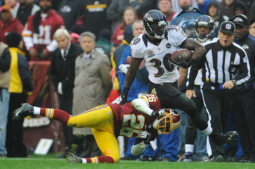 Description of . LANDOVER, MD - DECEMBER 09:  Bernard Pierce #30 of the Baltimore Ravens is tackled by Josh Wilson #26 of the Washington Redskins during the second half at FedExField on December 9, 2012 in Landover, Maryland.  (Photo by Patrick McDermott/Getty Images)