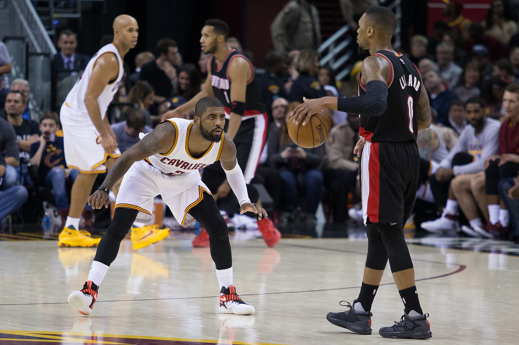 . Michael Johnson - The News-Herald Kyrie Irving of the Cleveland Cavaliers (left) defends Damian Lillard (right) during a home game against the Portland Trailblazers on November 23, 2016 at the Quicken Loans Arena. The Cavs defeated the Trailblazers 137-125