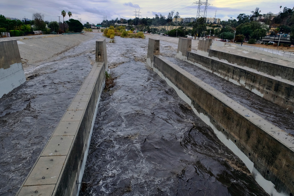. Rushing rainwater fills the Los Angeles river near downtown Los Angeles on Tuesday, Dec. 9, 2018. The first significant storm of the season walloped much of California with damaging winds and thunderstorms. (AP Photo/Richard Vogel)