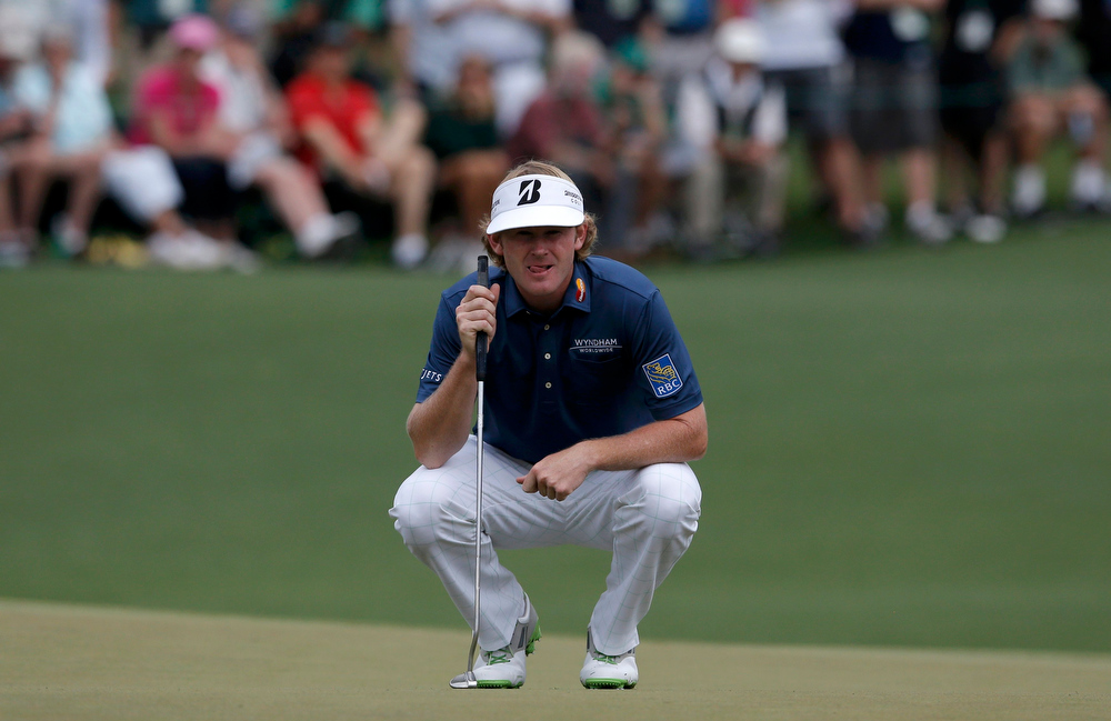 Description of . Brandt Snedeker of the U.S. lines up a putt on the second hole during first round play in the 2013 Masters golf tournament at the Augusta National Golf Club in Augusta, Georgia, April 11, 2013.  REUTERS/Phil Noble