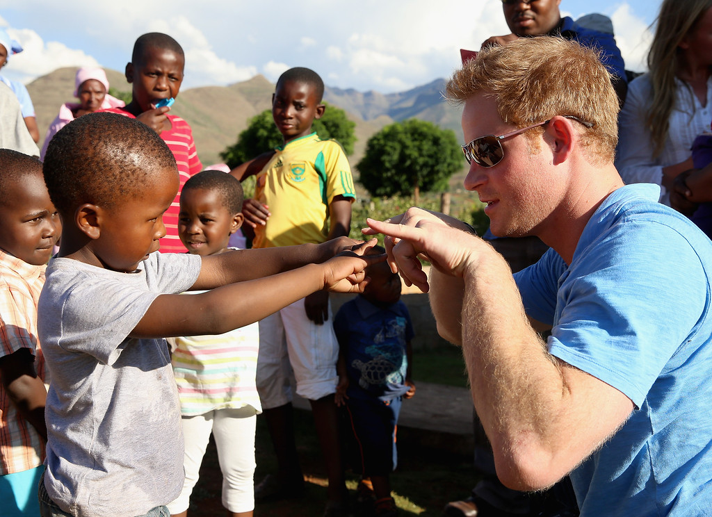 . Prince Harry plays with children during a visit to Phelisanong Children\'s Home on December 6, 2014 in Pitseng, Lesotho. Prince Harry was visiting Lesotho to see the work of his charity Sentebale.  (Photo by Chris Jackson/Getty Images for Sentebale)