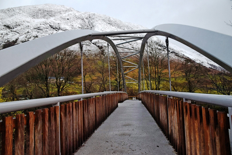 a walkway leading to a snowy mountaintop