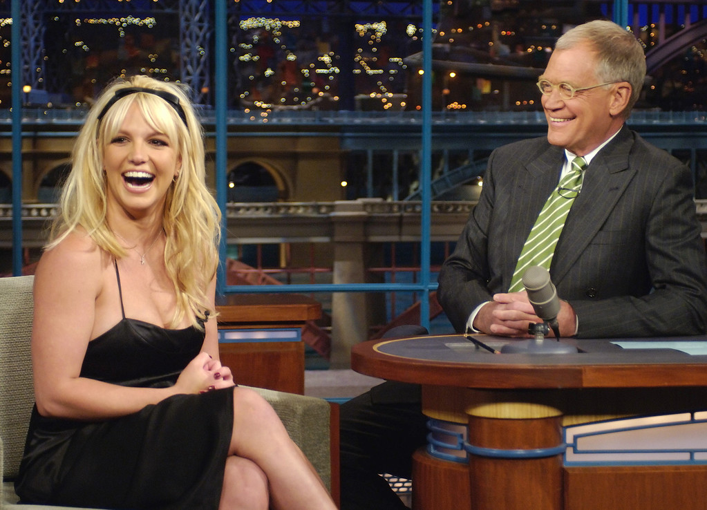 . In this photo released by CBS, pop singer Britney Spears shares a laugh with host David Letterman on the set of The Late Show with David Letterman, Tuesday, May 9, 2006 in New York. Spears announced on the show that she and husband Kevin Federline are expecting their second child. (AP Photo/CBS, Jeffrey Neira)