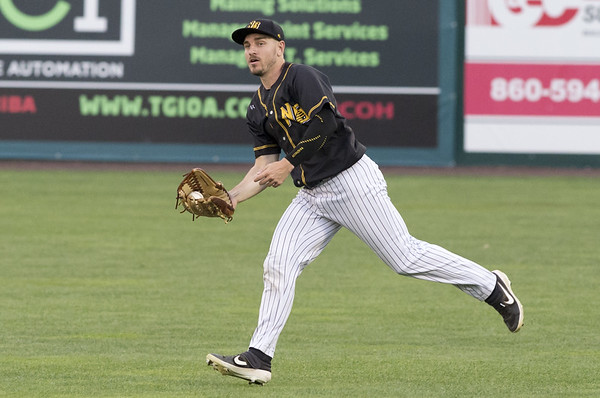 the New Britain Bees vs the High Point Rockers at New Britain Stadium on Tuesday August 13, 2019. Right fielder Bijan Rademacher (28) with a running catch in right field. | Wesley Bunnell | Staff