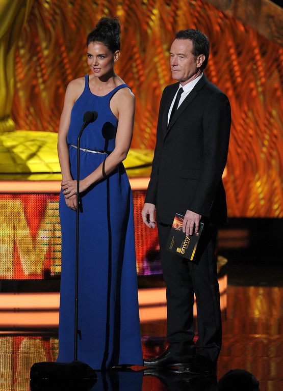 . Actors Katie Holmes (L) and Bryan Cranston speak onstage during the 63rd Annual Primetime Emmy Awards held at Nokia Theatre L.A. LIVE on September 18, 2011 in Los Angeles, California.  (Photo by Kevin Winter/Getty Images)