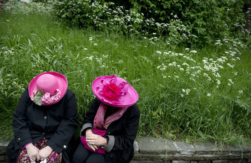 . Two ladies have a conversation while sitting on a wall at the Chelsea Flower Show in London on May 21, 2013. The world-famous gardening event run by the Royal Horticultural Society (RHS) is celebrating its centenary year. The Trailfinders Australian Garden was awarded Best Show Garden.   ADRIAN DENNIS/AFP/Getty Images
