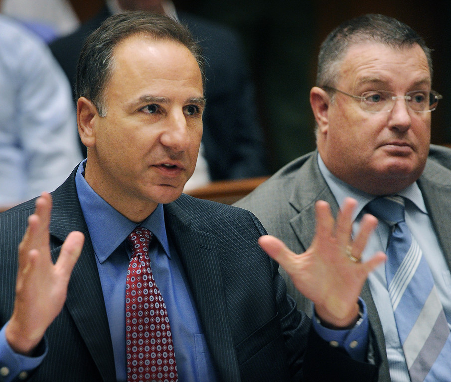 . District Attorney Habib Balian, left, sitting next to Timothy Miley, Sergeant Los Angeles County Sheriff\'s Department. A Los Angeles Superior Court judge Wednesday, August 15, 2013, sentenced a man who once posed as Clark Rockefeller to 27 years to life for murdering John Sohus in 1985. Christian Karl Gerhartsreiter, 52, will return to court next month for a restitution hearing. He has 60 days to file an appeal.(SGVN/Photo by Walt Mancini)