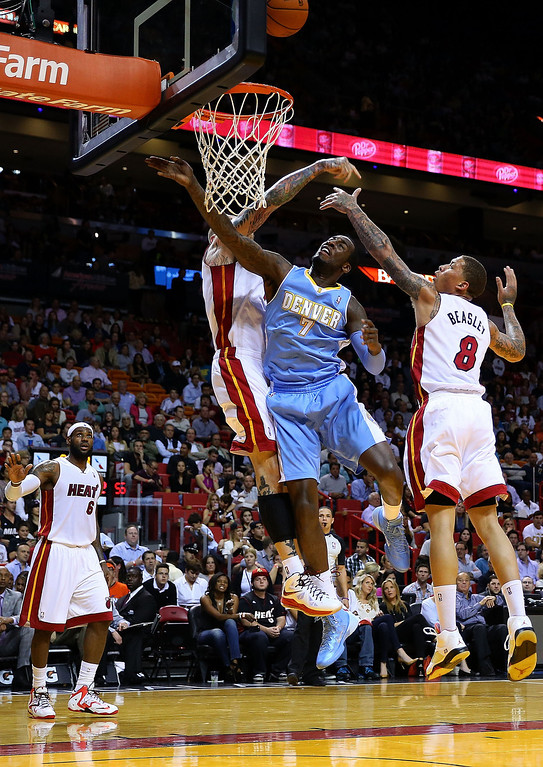 . MIAMI, FL - MARCH 14: J.J. Hickson #7 of the Denver Nuggets has a shot bocked by Chris Andersen #11 of the Miami Heat during a game  at American Airlines Arena on March 14, 2014 in Miami, Florida. (Photo by Mike Ehrmann/Getty Images)