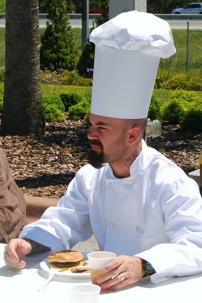 012 Chef Chris Sampling His Creation.jpg