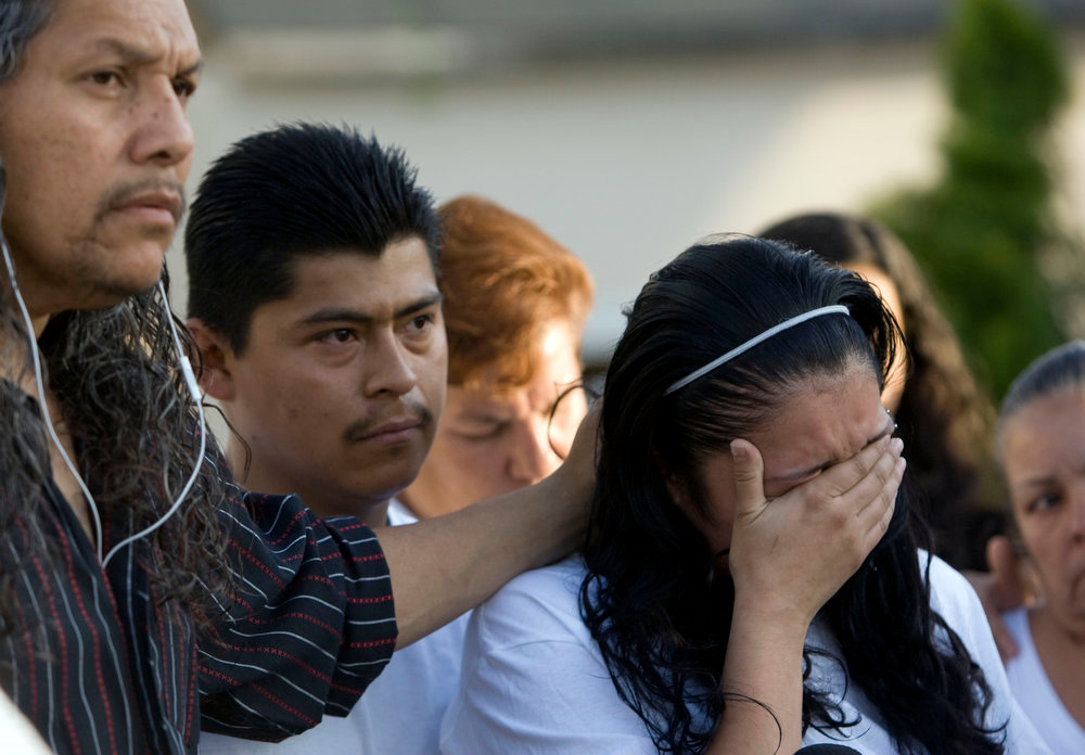 . Johana Portillo-Lopez, daughter of Ricardo Portillo, who passed away after injuries he sustained after an assault by a soccer player at a soccer game he was refereeing on April 27, is comforted by Antonio Lopez, left, brother-in-law of Ricardo, as she speaks about her father\'s death during a press conference in Salt Lake City on Sunday, May 5, 2013. (AP Photo/The Salt Lake Tribune, Kim Raff)