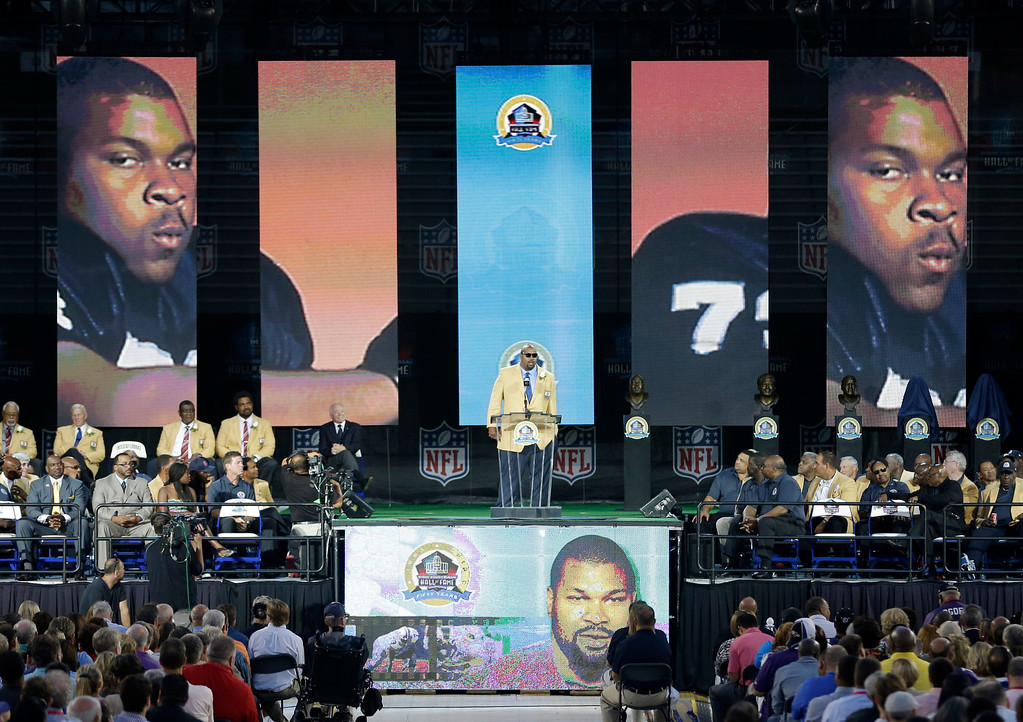 . Former NFL football player Larry Allen speaks during the induction ceremony at the Pro Football Hall of Fame Saturday, Aug. 3, 2013, in Canton, Ohio. (AP Photo/Tony Dejak)