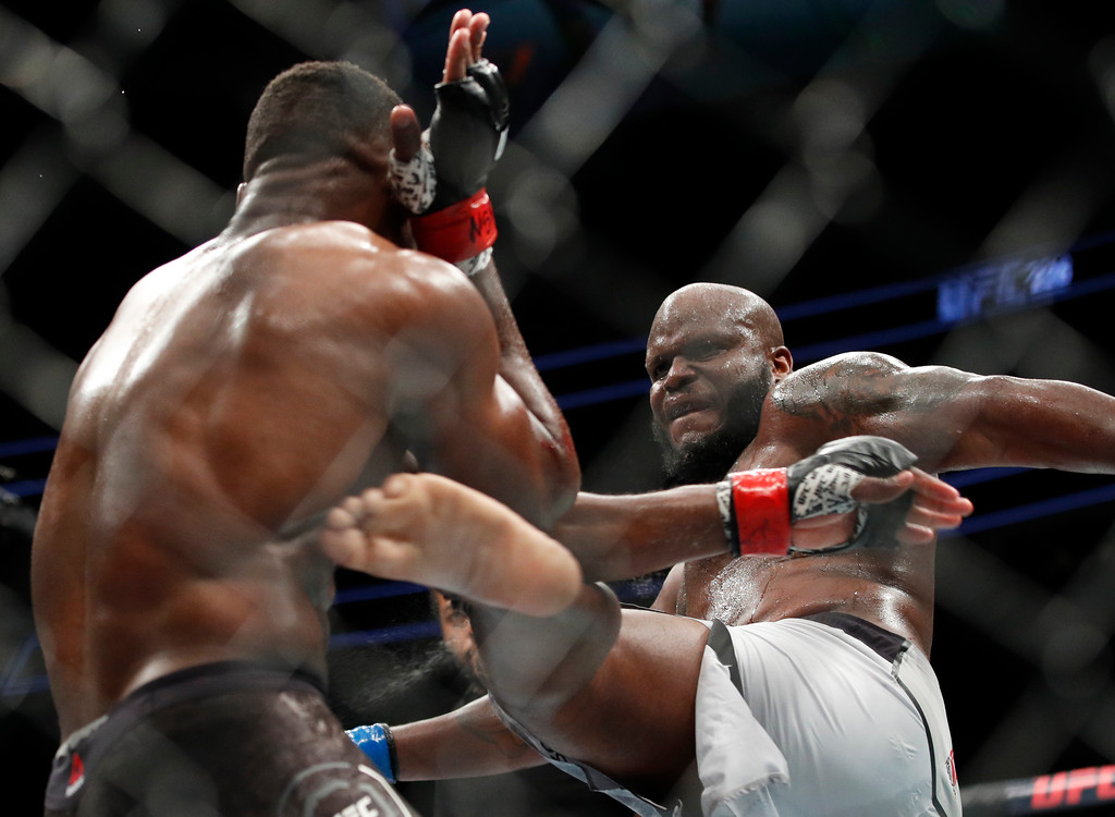 . Derrick Lewis kicks Francis Ngannou during a heavyweight mixed martial arts bout at UFC 226, Saturday, July 7, 2018, in Las Vegas. (AP Photo/John Locher)