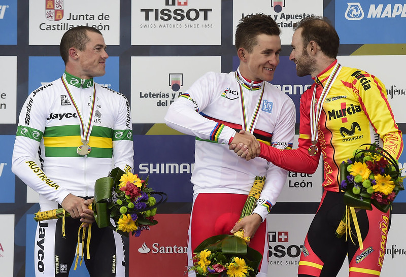 . Gold medalist Poland\'s Michal Kwiatkowsk (C), silver medalist Australia\'s Simon Gerrans (L) and bronze medalist Spain\'s Alejandro Valverde celebrate on podium of the men\'s road race at the 2014 UCI Road World Championships in Ponferrada on September 28, 2014. JAVIER SORIANO/AFP/Getty Images