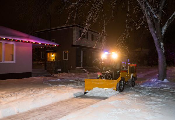 DAVID LIPNOWSKI / WINNIPEG FREE PRESS  Equipment operator for the City of Winnipeg Public Works Department, Michael Correia, cleans sidewalks in River Heights Wednesday December 26, 2018.